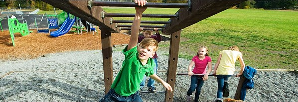 Strengthening their arm muscles through playing in the playground